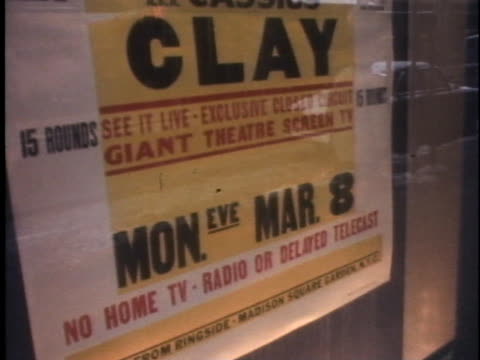 poster outside radio city music hall advertises the championship boxing match between muhammad ali and joe frazier. - document stock videos & royalty-free footage