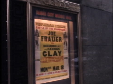 poster outside radio city music hall advertises the championship boxing fight between muhammad ali and joe frazier. - document stock videos & royalty-free footage