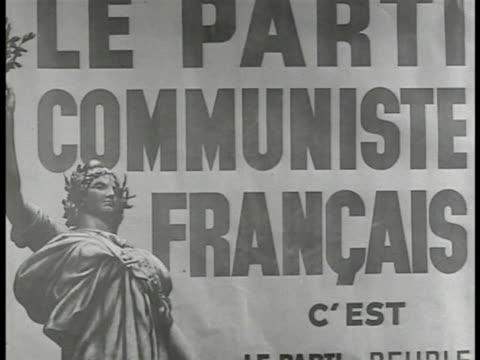 Poster 'Parti Communiste Francais' MS French Communist leader Maurice Thorez at desk talking MS Jacque Doclot at table talking CU Thorez talking PCF