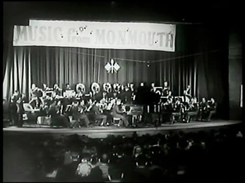 concert poster sign 'sgt eugene list playing rachmaninoff' int auditorium w/ signal corps band on stage sgt list sot playing piano cu hands playing... - music poster stock videos & royalty-free footage