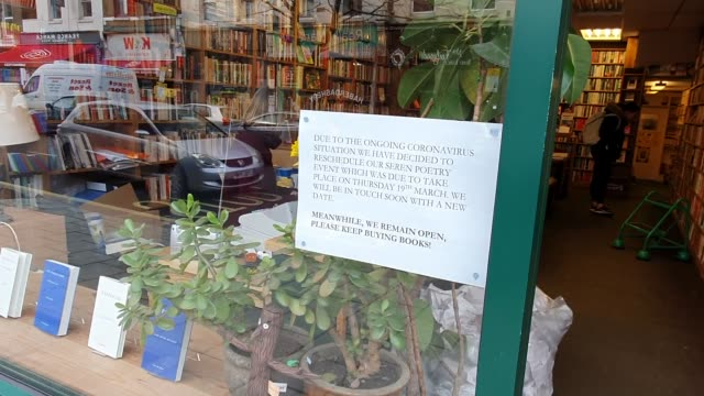 a poster tells book shop customers that an event has been cancelled due to the coronavirus pandemic in east dulwich on march 17 2020 in london england - brian dayle coronavirus stock videos & royalty-free footage