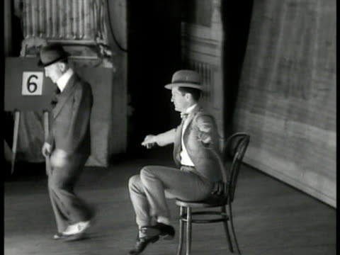 'the barber dan duo' cu poster 'welton morgan' vs welton morgan tap dancing on stage la ms audience in balcony box seats clapping ms duo singing... - tap dancing stock videos & royalty-free footage