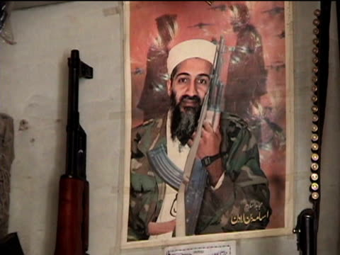 poster with usama bin laden holding kalashnikov, sakha kot in tribal zone at afghan border, federally administered tribal areas, pakistan, audio - male likeness stock videos & royalty-free footage