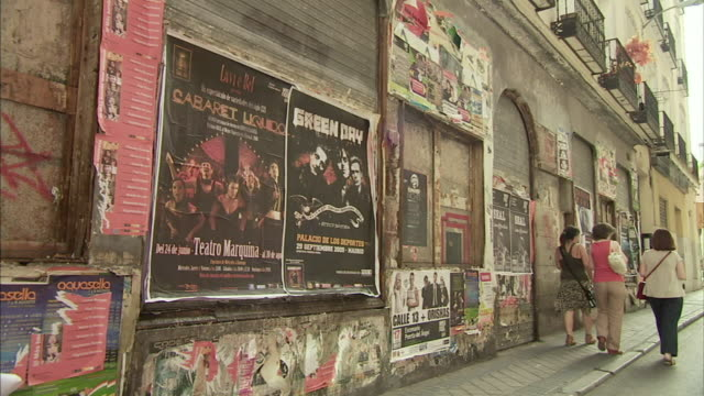 ws posters and graffiti on madrid street / madrid, spain - poster stock-videos und b-roll-filmmaterial