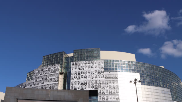 posters featuring portraits of health workers on the facade of the opera bastille on june 08, 2020 in paris, france. french street artist and... - バスティーユ点の映像素材/bロール
