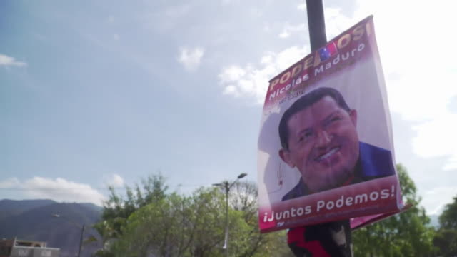 posters featuring the face of late venezuelan president hugo chavez urging people to vote for current president nicolas maduro being taken down from... - socialism stock videos & royalty-free footage