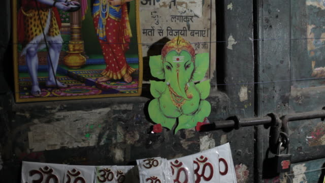 CU Posters of Ganesh and stickers with OM in Hindi / India