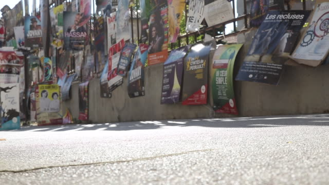 posters of shows in the street during the avignon festival - poster wall stock videos & royalty-free footage