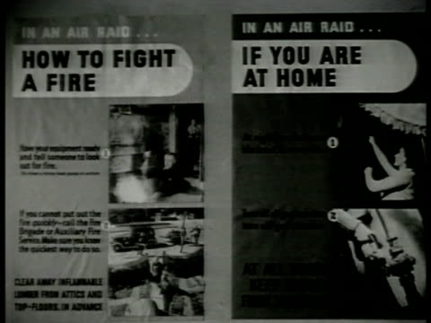 vídeos de stock e filmes b-roll de posters w/ pictorial amp written instructions 'in a raid how to fight a fire if you are at home' cu banner w/ warden blowing whistle 'in a raid... - aparelhagem de áudio