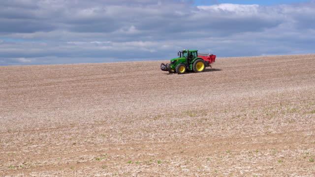 post-harvest field being reworked - traktor stock-videos und b-roll-filmmaterial