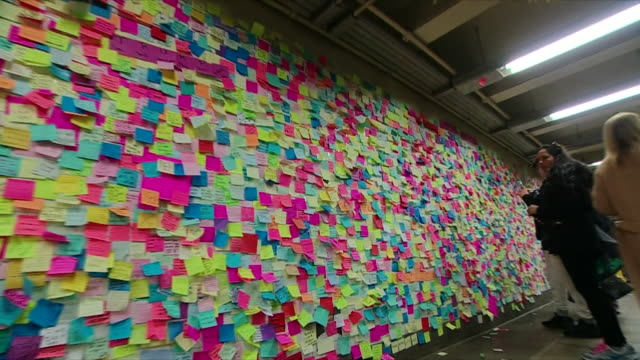 A postit note protest in a New York City subway station against the Presidentelect Donald Trump