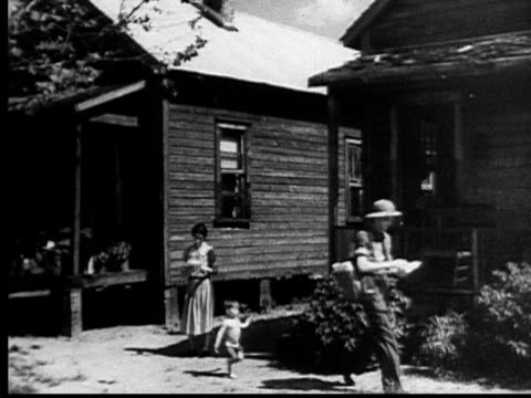 1935 film montage ws postman delivering letter to woman standing outside house/ ws little boy following postman as he leaves/ ms woman reading letter/ jacksonville, florida - united states postal service stock videos & royalty-free footage