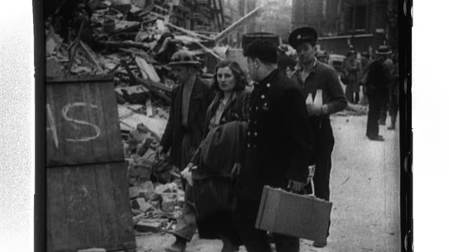 a postman delivers mail to a london citizen who lives in the debris of a building while king george vi and queen elizabeth comfort luftwaffe bomb... - postal worker stock videos & royalty-free footage