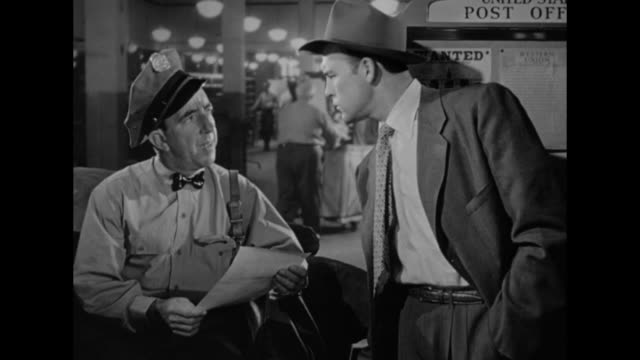 1948 postman provides important information in manhunt - 1948 stock-videos und b-roll-filmmaterial