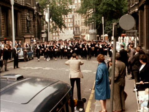postmen take part in a walking race around the city of london 1968 - concorso video stock e b–roll
