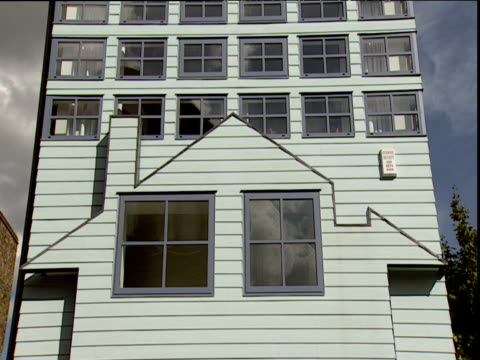post-modern design of house on tall building - postmodern stock videos and b-roll footage