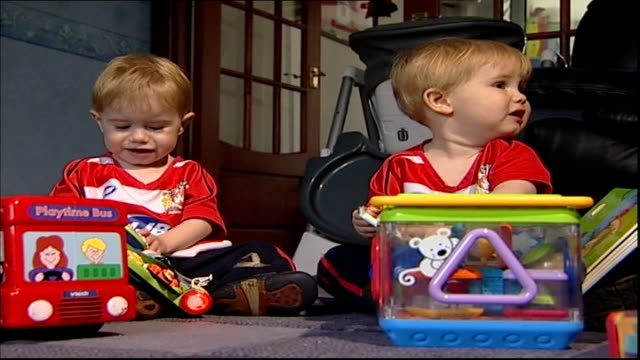 post-natal depression: close up; cutaway lindsay's young twins playing on floor - postpartum depression stock videos & royalty-free footage