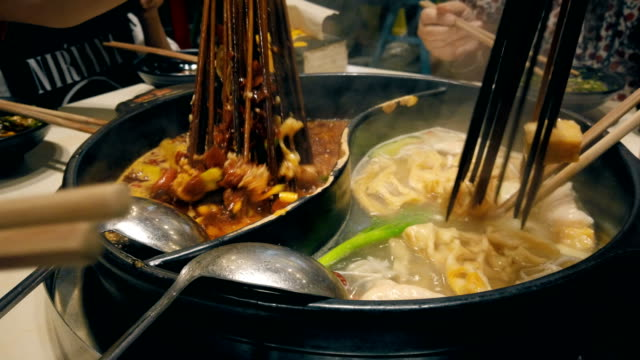 a pot of chuanchuan (skewer in spicy hotpot) - skewer stock videos & royalty-free footage