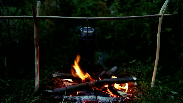 pot of porridge on the campfire - boy scout stock videos & royalty-free footage
