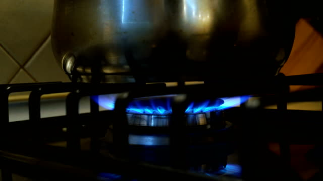 pot on the gas stove - gas stove burner stock videos and b-roll footage