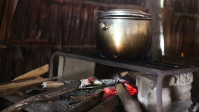 Pot on wood stove_handheld medclose