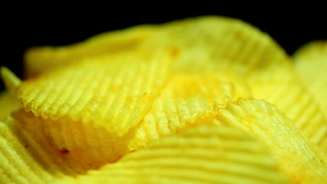 potato chips close up dolly shot - salty snack stock videos & royalty-free footage