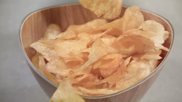 potato chips falling into bowl (super slow motion) - salty snack stock videos & royalty-free footage
