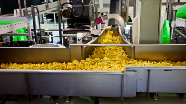 potato crisp factory - food and drink stock videos & royalty-free footage