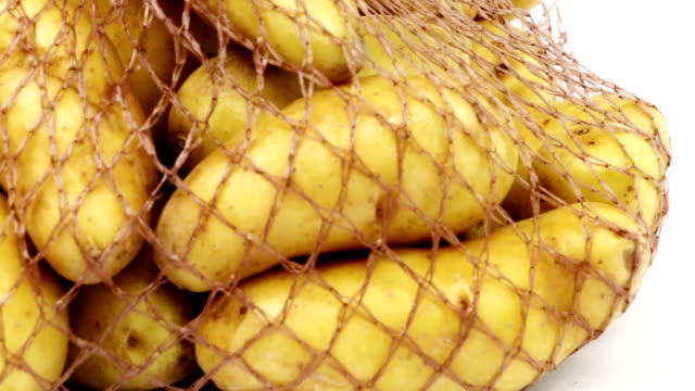 potato in shopping net - netting stock videos & royalty-free footage