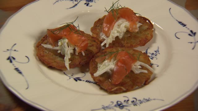 potato pancakes with smoked salmon on a plate at bohemian house on oct. 29, 2014 in chicago. - salmon stock videos & royalty-free footage