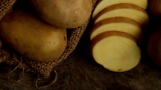 potato sliced at kitchen - raw potato stock videos & royalty-free footage