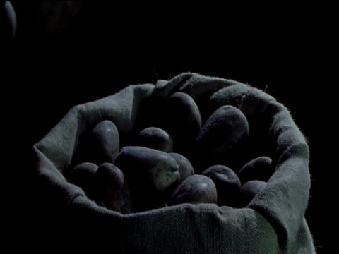 potatoes are thrown into overflowing sack, uk - sack stock videos & royalty-free footage