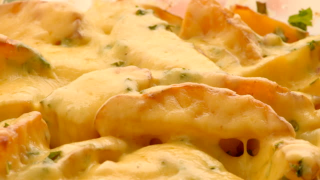 potatoes baked with cheese in oven - spinning point of view stock videos & royalty-free footage