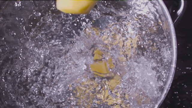 potatoes falling into boiling water super slow motion 1000 fps - boiling stock videos & royalty-free footage