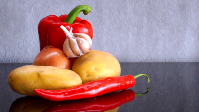 potatoes, garlic, onion, red bell pepper and red chili pepper zoom in - red potato stock videos & royalty-free footage