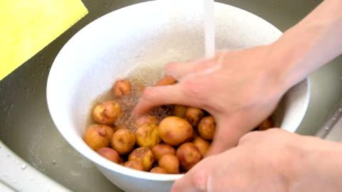 potatoes under running water - washing stock videos & royalty-free footage