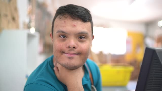 potrait of a special needs cashier working in a store - down's syndrome stock videos & royalty-free footage
