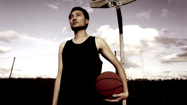 Potrait of Chinese male with basketball