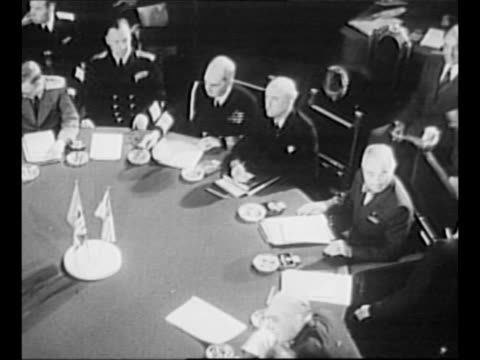 potsdam conference attendees at round table, with clerks at desks in foreground / us president harry s truman sits at table, with centerpiece of... - potsdam brandenburg stock videos & royalty-free footage
