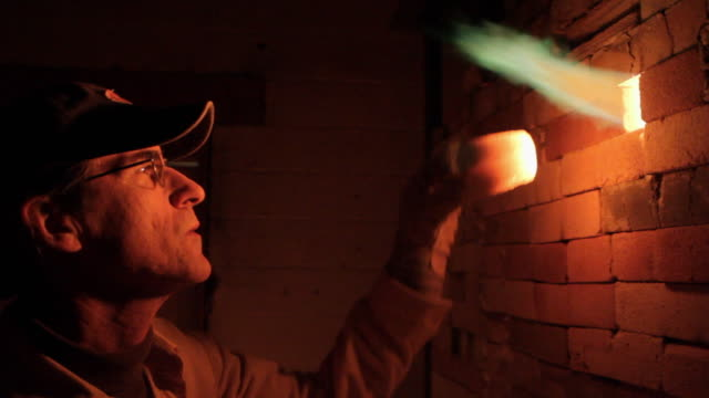 cu potter checking flame on kiln / frenchtown, new jersey, usa  - potter stock videos & royalty-free footage