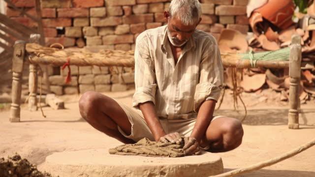 potter kneading clay, faridabad, haryana, india - only mature men stock videos & royalty-free footage