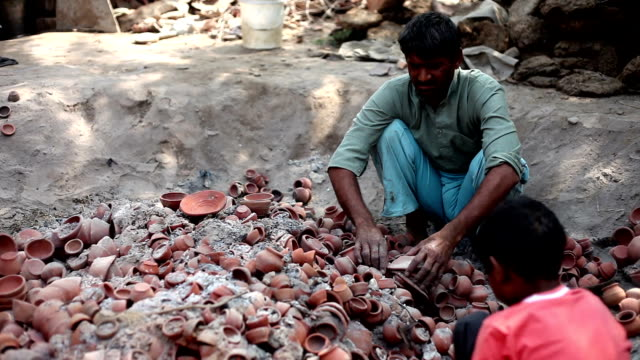 potter remove the fired clay pots - potter stock videos & royalty-free footage