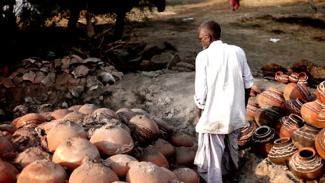 potter remove the fired clay pots - dhoti stock videos & royalty-free footage