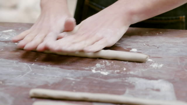 potter rolling clay on table at workshop - clay stock videos & royalty-free footage