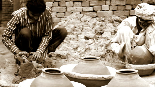 potter shaping a pot at his home - poverty stock videos & royalty-free footage