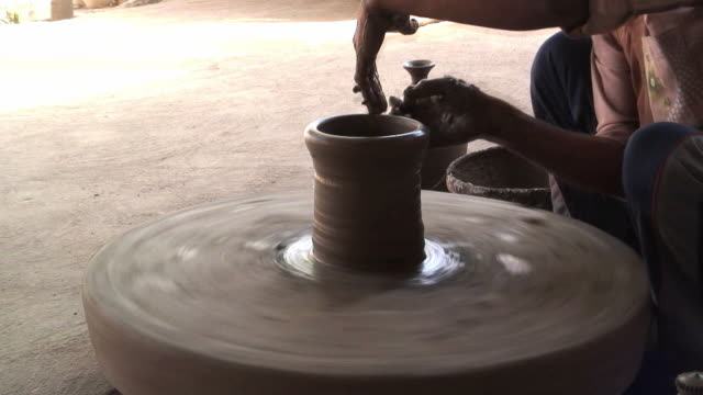 ms t/l potter shaping clay on potter's wheel / jodhpur, india - potter's wheel stock videos & royalty-free footage