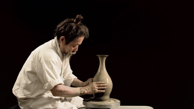 MS Potter shaping clay on potter's wheel / Kyunggido, South Korea