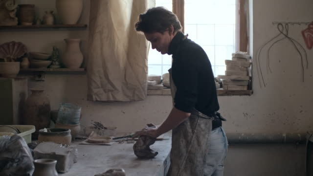 potter wedging clay in studio - only mature men stock videos & royalty-free footage