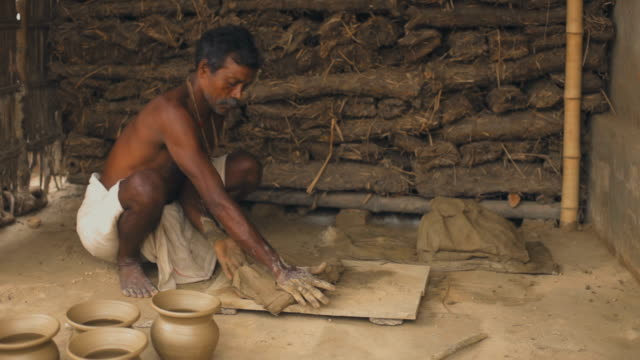 potter works manually in his adobe workshop for the livelihood. - potter stock videos & royalty-free footage
