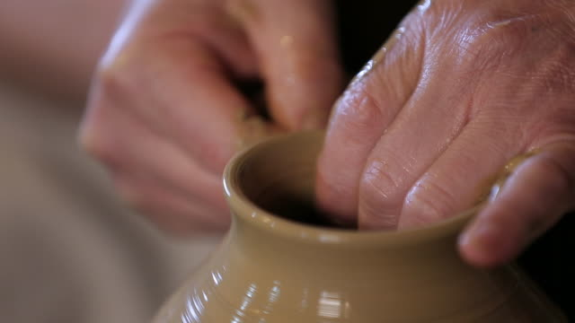 pottery artist making a shape from clay in daejeon - potter's wheel stock videos & royalty-free footage